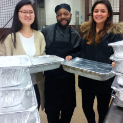 students of the UIC Chapter of the Food Recovery Network pack up leftover food with UIC Dining staff to be donated.
