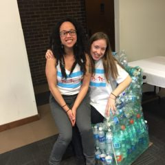 freshwater lab students sit on a chair constructed entirely out of reclaimed plastic water bottles