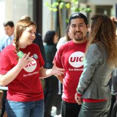 EcoVolunteers talk to faculty at a UIC event