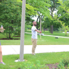 students measure the height of tree using a Biltmore stick
