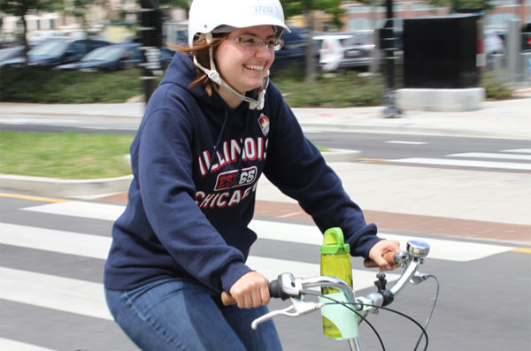 Student biking east on Harrison Street on top of a super snazzy bike
