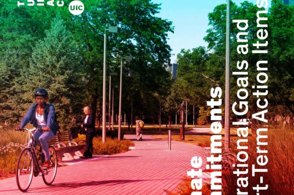 student riding a bike through the Grove serves as the cover of the UIC Climate Commitments.