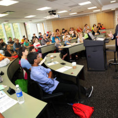 visitors listen to a presentation about the College of Business in Douglas Hall at Open House Photo: Julie Jaidingder