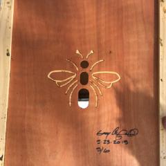 bee artwork carved on wood