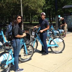 students checking out a Divvy bike near the Daley Library