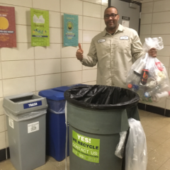 BSW LaShun Nicholson moves the bottles and cans bag of recycling into a rolling cart