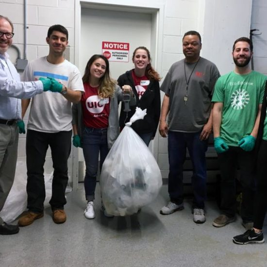 UIC Staff, volunteers, and Bright Beat eco-educators weigh recyclables at the Good Food Festival
