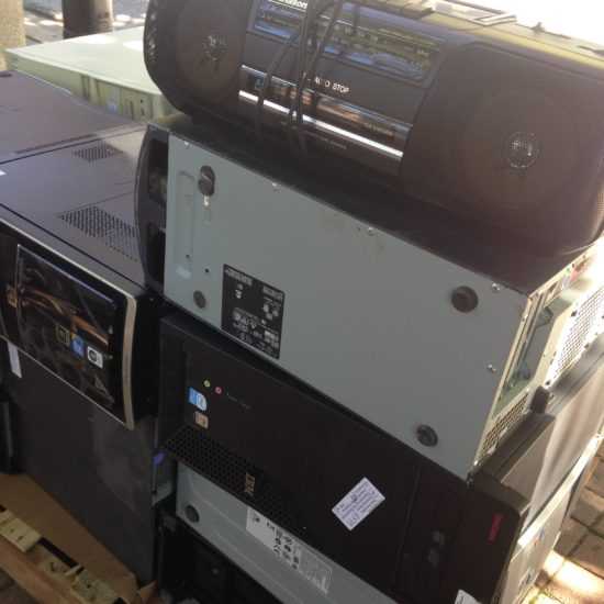 Pile of old campus electronics like CPU's and boomboxes to be recycled