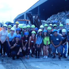 2015 SIP cohort with hard hats at the recycling plant tour
