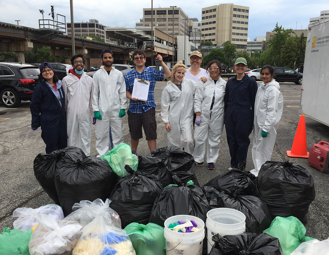 Students don white safety coveralls during the Hospital waste audit
