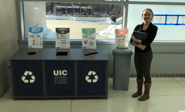 UIC Student standing near eco-stations at the UIC Forum