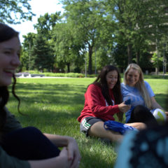 students sitting in the grass hanging out (Photo: Callie Lipkin)