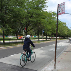 UIC Student riding east on Harrison street near University hall in a clear bike lane