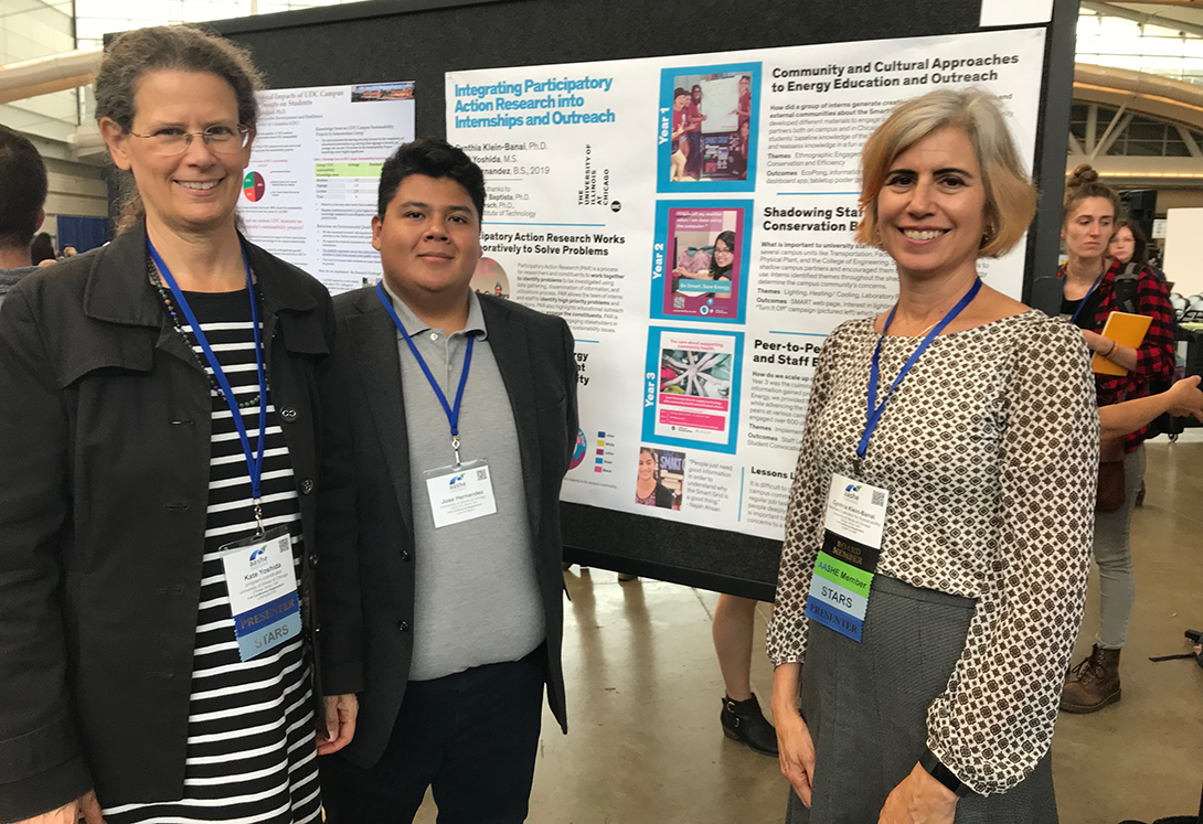 Kate Yoshida, Jose Hernandez and Cindy Klein-Banai stand next to their poster at the AASHE conference