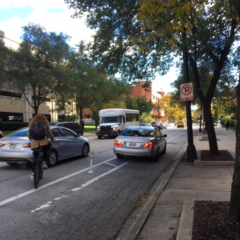 A car parked in the bike lane on eastbound Harrison street near the College of Medicine forces a cyclist out into the traffic lane with cars