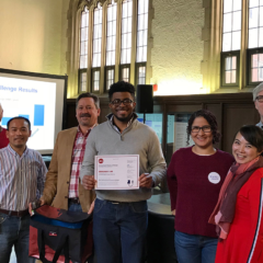 winning lab accepts certificate for winning the lab freezer challenge