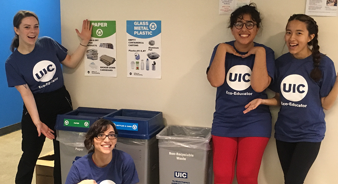student recycling team shows off the 3 set recycling bins on campus