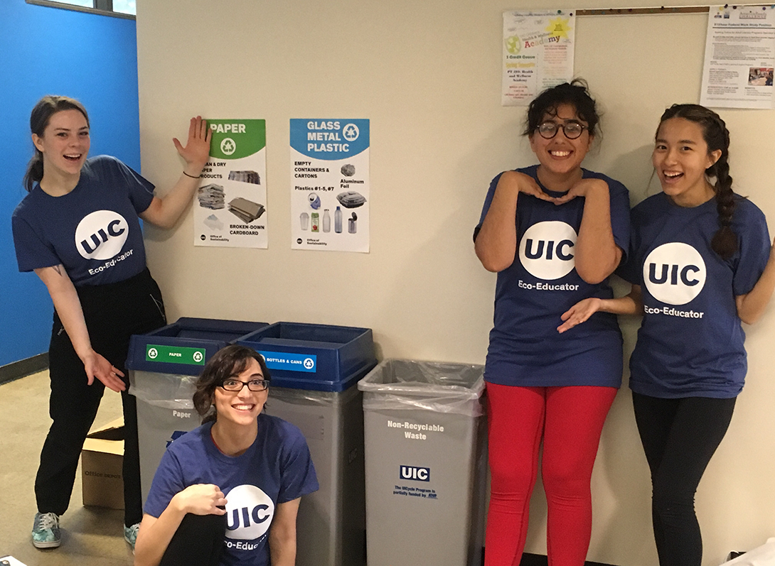 UIC students show off the new recycling posters