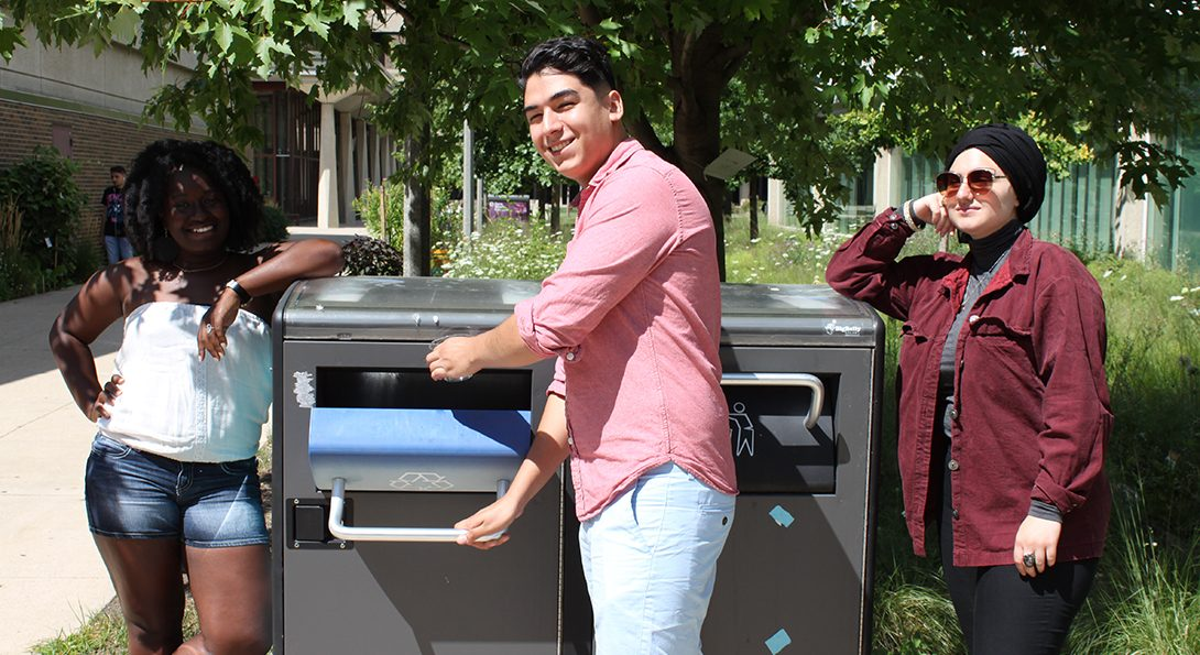 students recycling outside in a