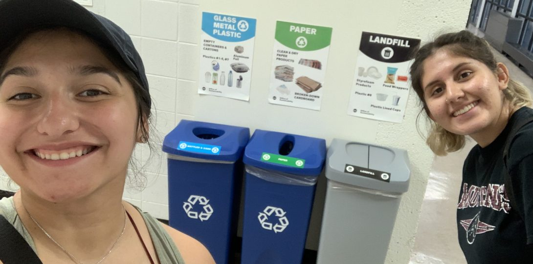 the 2019 student recycling team shows off the 3 set recycling bins on campus