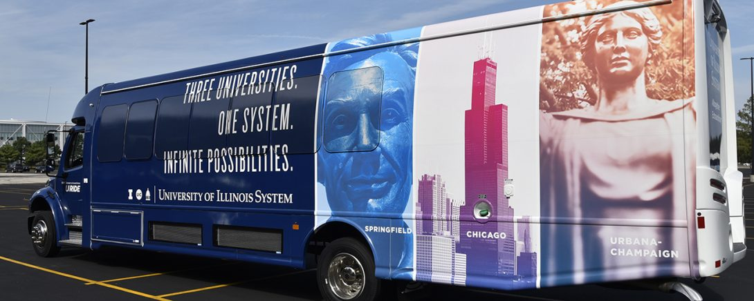UI Ride shuttle bus with slogan,