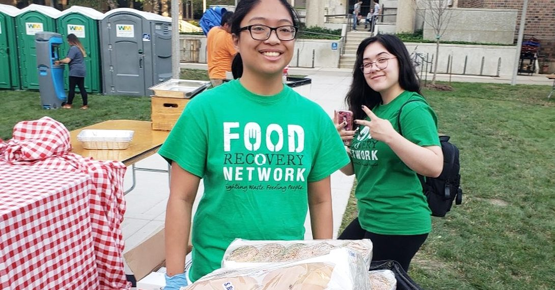 Food Recovery Network students pack left over food at the UIC Convocation