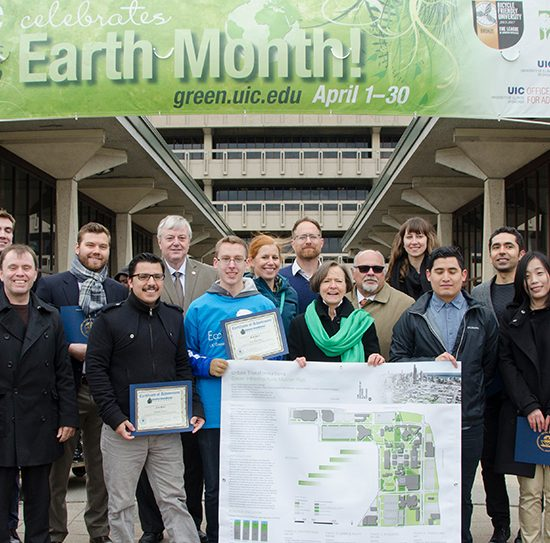 students and faculty stand with the Chancellor and EPA region 5 administrator as they accept the award for the campus rainworks challenge
