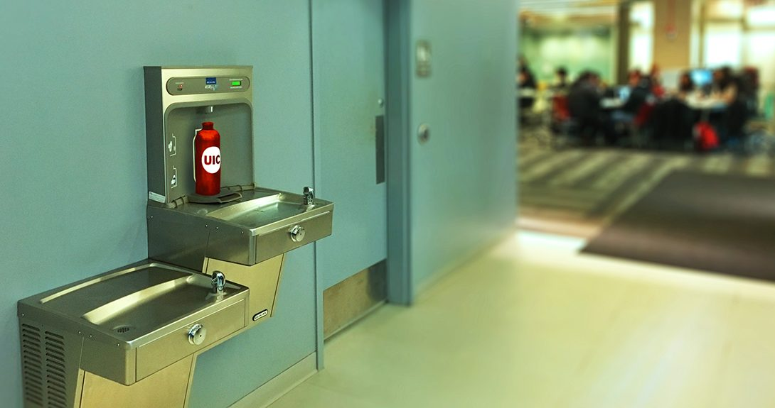 UIC branded water bottle sits waiting to be filled at a water bottle refill station in the Daley Library