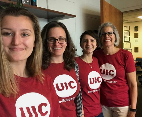 4 staff members wearing red UIC t shirts.