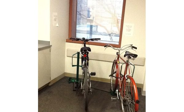 bicycles parked inside a UIC building on secure racks