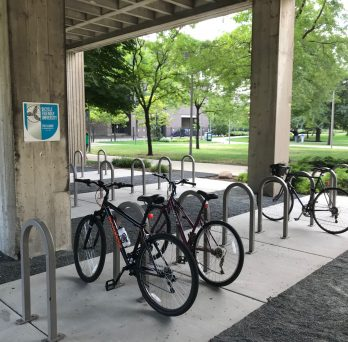 Bikes locked to a bike rack underneath the Science and Engineering Office Building.