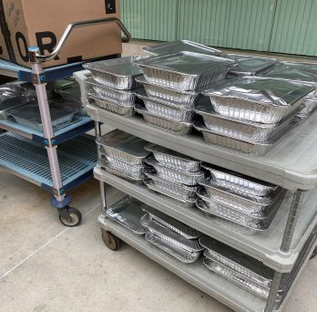 Food from the UI Hospital has been packaged in aluminum containers and is ready to be transported to Fransiscan House, a nearby homeless shelter.