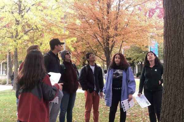 student leading a group around the east campus
